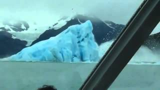 Iceberg flips over, amazing tourists