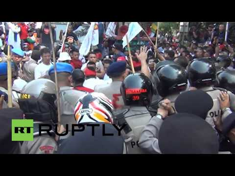 Indonesia: Watch Jakarta police fire tear gas, water cannons at protesters