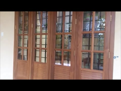 Wooden front window design kerala home youtube for Window frame designs house design