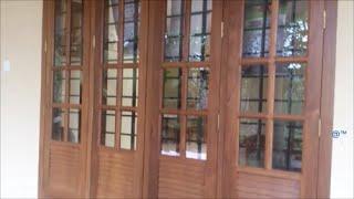 Wooden Front Window Design ( Kerala Home )