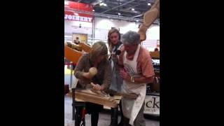 Tony Dew Showing Maggie Philbin How To Carve A Rocking Hors