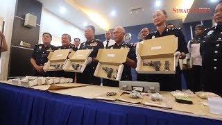 Cops seize semi-automatic guns, heroin in Penang house raid