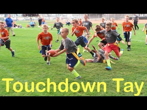 KID SCORES TOUCHDOWNS RUNNING TRICK PLAYS AT FOOTBALL GAME!