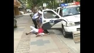 China - Shanghai police officer throw woman with baby on the street