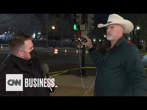 CNN reporter talks to Trump conspiracy theorist at Biden's inauguration