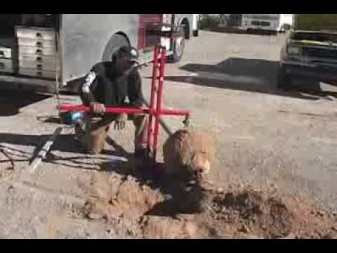 The Bullpull Removes Concrete Chain Link Fence Post Youtube