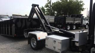 For Sale - 2010 Isuzu NPR Roll-Off Truck With Flat Bed and 16yrd Bin
