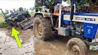 John Deere tractor stuck in mud and Swaraj 744 pulling out from mud