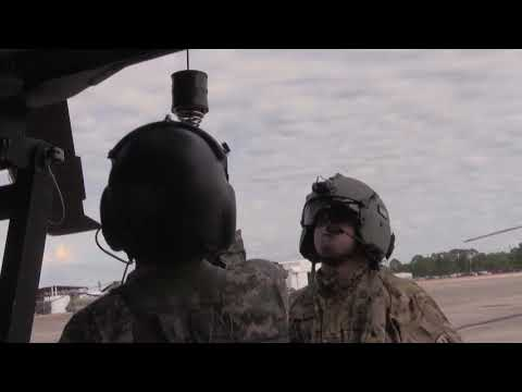 Soldiers from Golf Company 1-168 Medevac perform hoist training