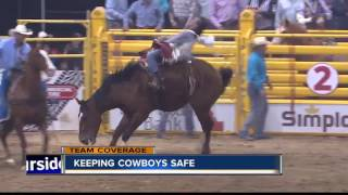 Volunteers work to keep cowboys safe at the Snake River Stampede in Nampa
