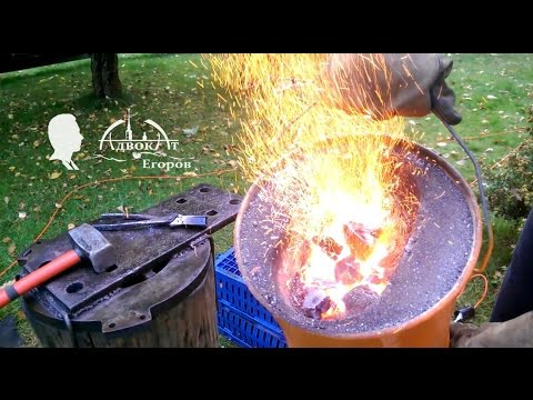 Homemade forge out of two buckets and the fan forge