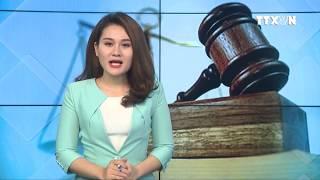 TTXVN - Đưa tin Sinh viên Khoa Luật, ĐHQGHN giao lưu với Chánh án TAND tối cao Nguyễn Hòa Bình