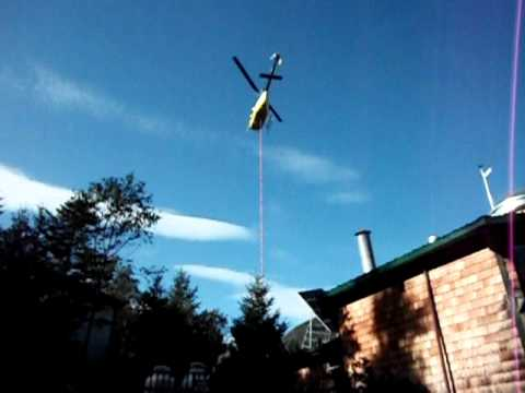 Helicopter dropping off supplies at the Lonesome Lake hut, White Mts, NH