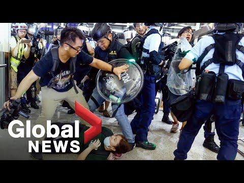 Hong Kong police face off with protesters as airport protests erupt in chaos