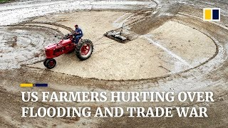US farmers hurting over flooding and trade war