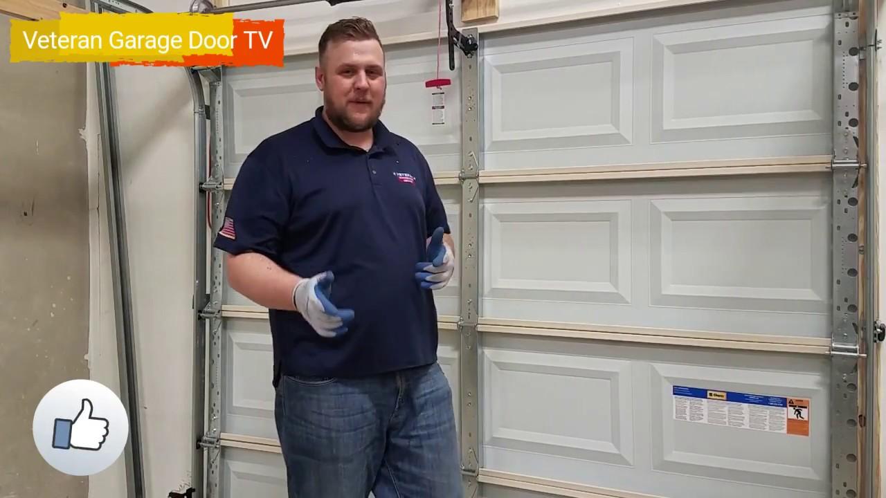 Open garage door manually veteran garage door youtube for Veteran garage door