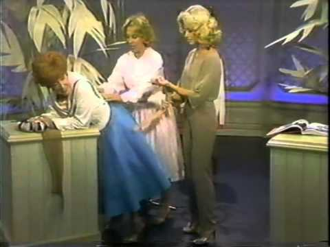 Dody Goodman Demonstrates a Girdle for Dinah Shore and Olivia NewtonJohn