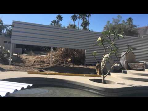 Putting up a corrugated fence in Rancho Mirage