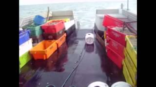 Whelk Pots being put back out to fish...
