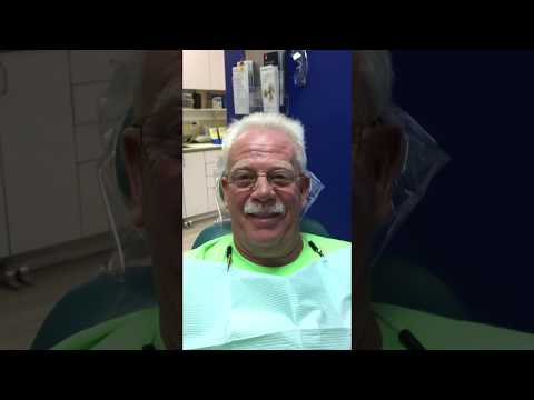 Patient is happy with SnapInDentures installed by Affordable Dentures