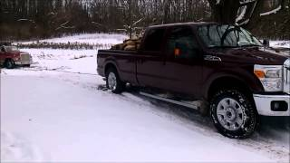 2012 Ford F-250 attempting to free a stuck dump truck