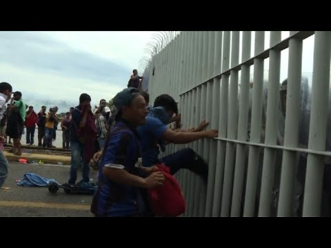 Migrants cross Guatemala-Mexico border after clashes