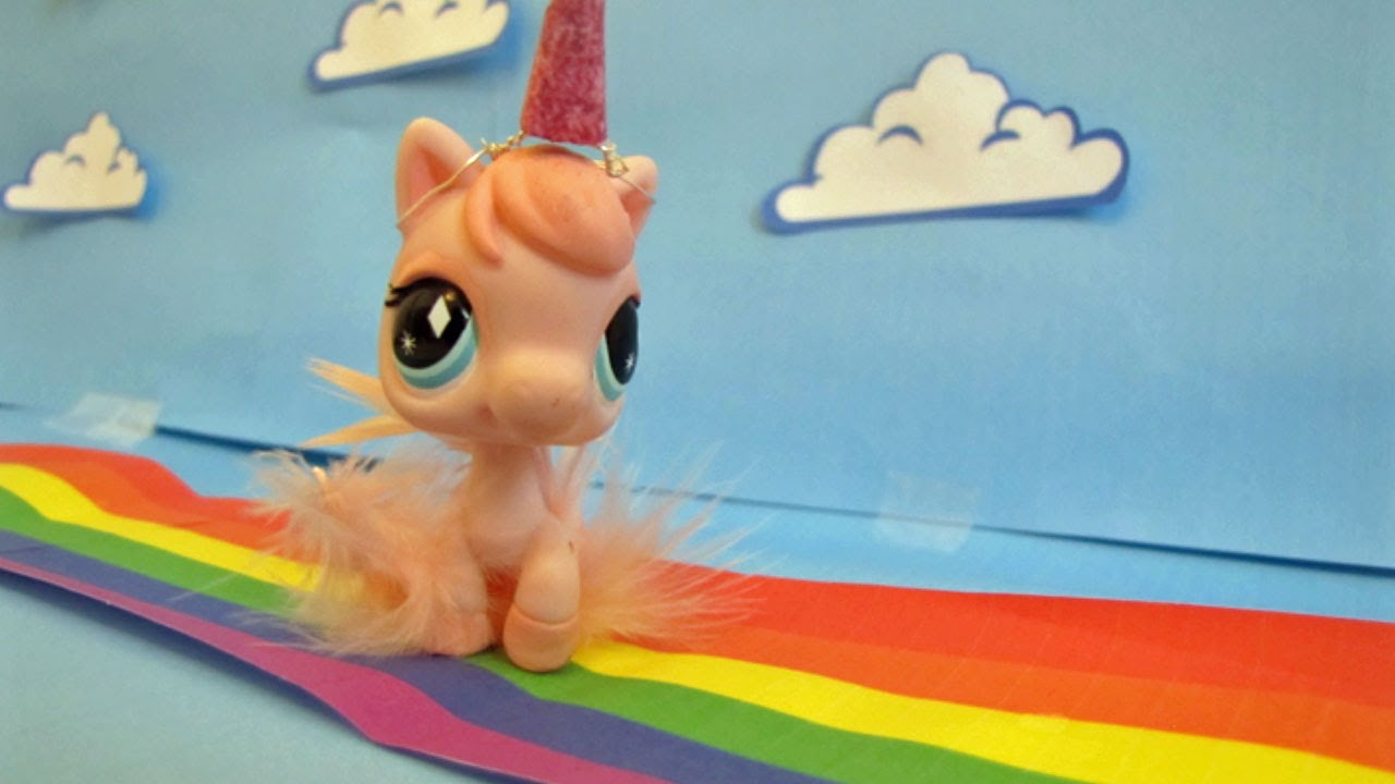 pink fluffy unicorns dancing on rainbows gif