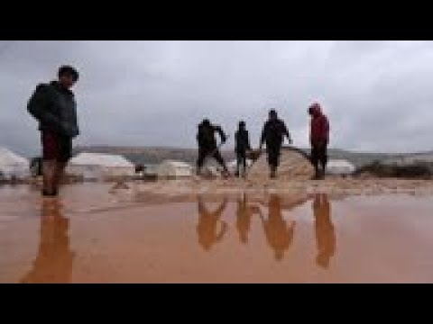 Rain brings trouble for Syrians displaced in tents