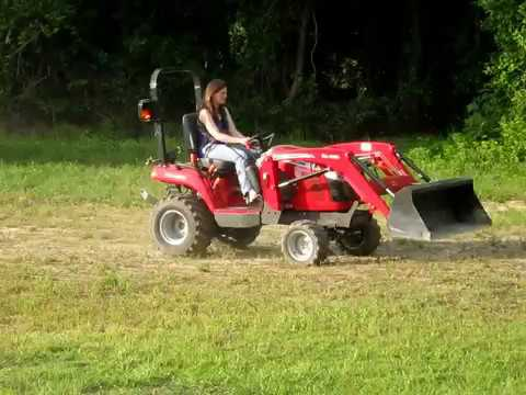 My wife driving our new Massey Ferguson GC2600 - YouTube
