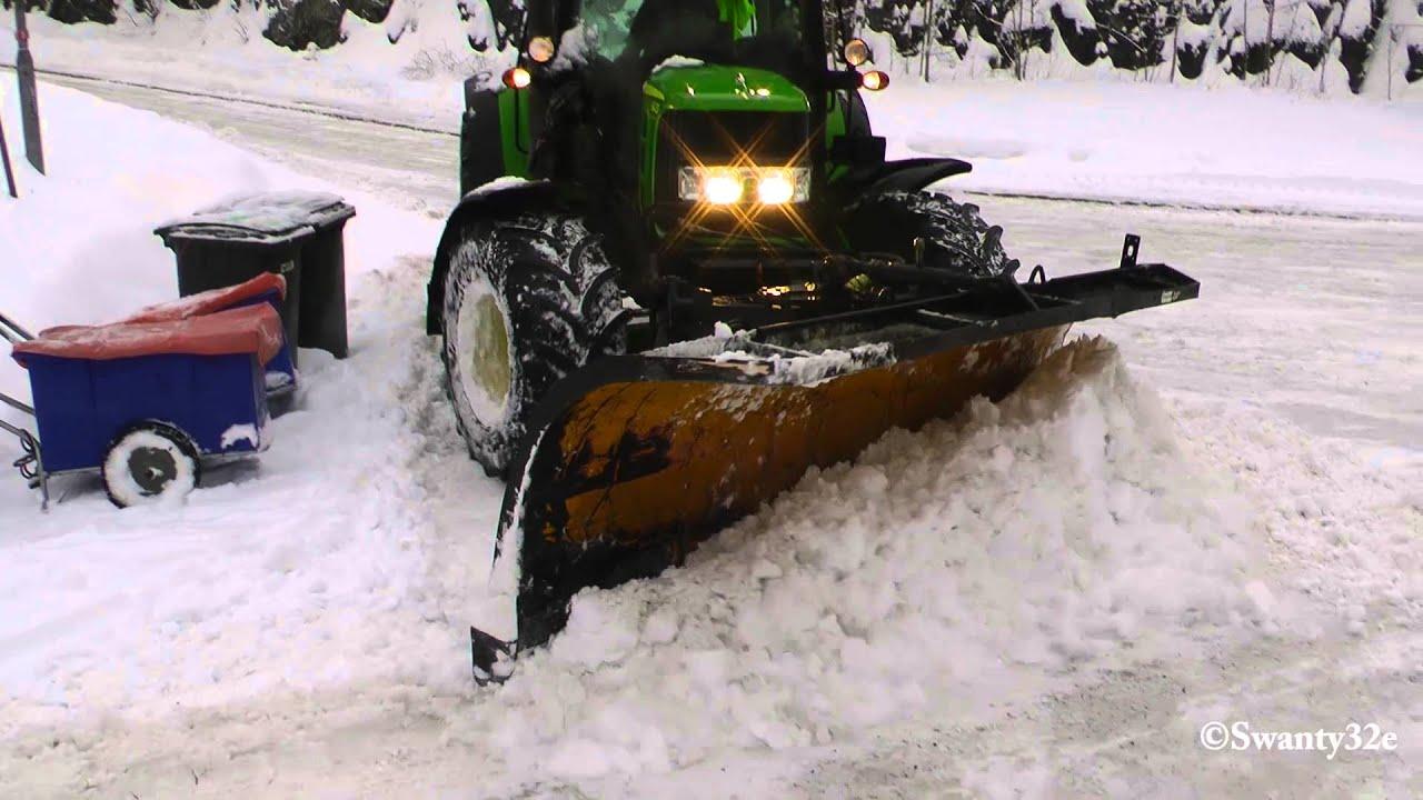 John Deere Plowing Snow