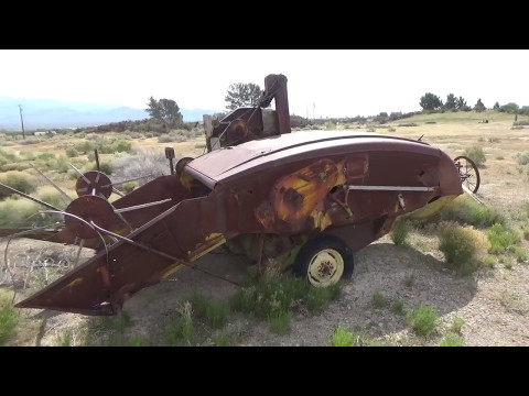 Neat old deserted antique farm implements