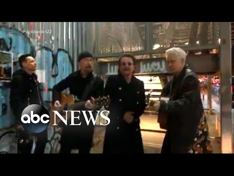 U2 performs a surprise pop-up concert on NYC street corner