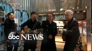 U2 performs a surprise pop-up concert on NYC street corner