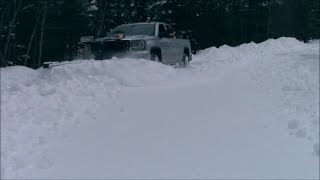 Plowing over 1 foot of snow in a parking lot