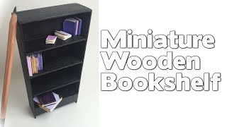 I created a little wooden bookshelf for my dollhouse using extra large craft sticks, matchsticks, and a small piece of wood (for the...