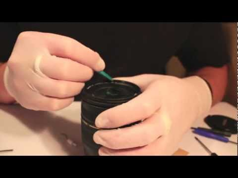 Cleaning behind the front glass of a camera lens.