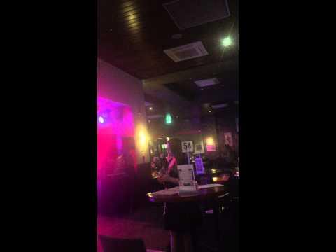 Lauren singing at the local pub karaoke