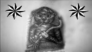Что значит тюремная татуировка, где кот держит в лапах связку ключей?