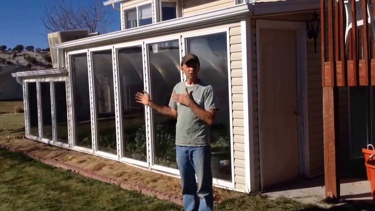 Design an attached winter greenhouse solar thermal mass for Sunroom attached to house