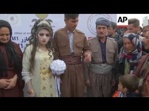 Mosul couple weds in displaced people camp