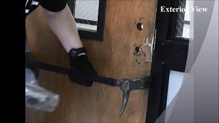 Police Officer Testing Nightlock Lockdown Door Barricade for Classroom Doors