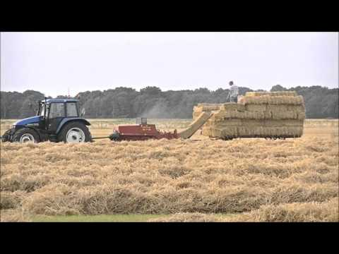 New Holland TS115 Baling and Loading Small Bales.