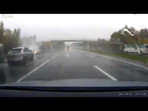 Aquaplaning and unexpected impact of the car on a wet highway