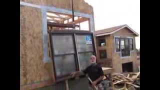 Old town Beam Boy Installs a Window during home remodel