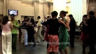 Indian women and men learn to Salsa