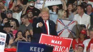 Trump hammers away on theme of migrant caravan to encourage voters