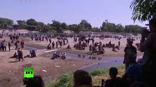 Migrants attempt to cross the river at Mexico-Guatemala border