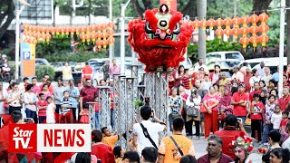 Multi-racial crowd throngs MCA's annual Chinese New Year open house