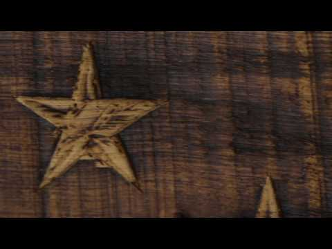 The Hand Carved Heritage Flag