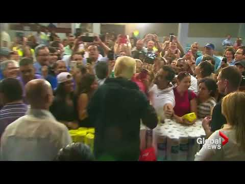 Donald Trump throws paper towels into crowd at Puerto Rico relief center
